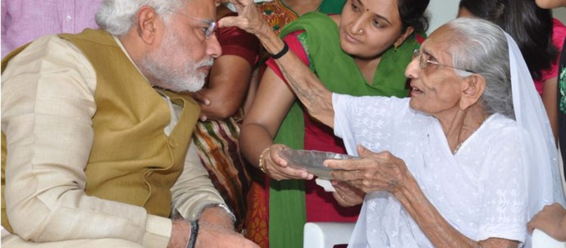 Narendra Modi meets his mother after winning the elections